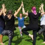 Yoga students having fun after successful application