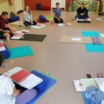 Yoga trainee teachers learning on course